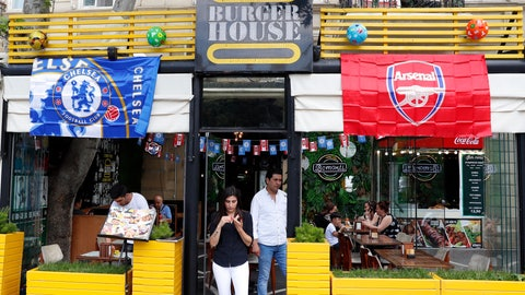 <p>               A restaurant is decorated with Chelsea and Arsenal flags, in central Baku, Azerbaijan Tuesday, May 28, 2019. Supporters were arriving in the Azerbaijan capital ahead of Wednesday's Europa League final between English teams Arsenal and Chelsea. (AP Photo/Darko Bandic)             </p>