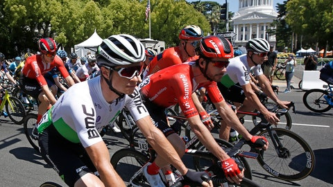 <p>               The peloton passes the California state Capitol as the riders go into a turn during the first stage of the Amgen Tour of California cycling race Sunday, May 12, 2019, in Sacramento, Calif. (AP Photo/Rich Pedroncelli)             </p>