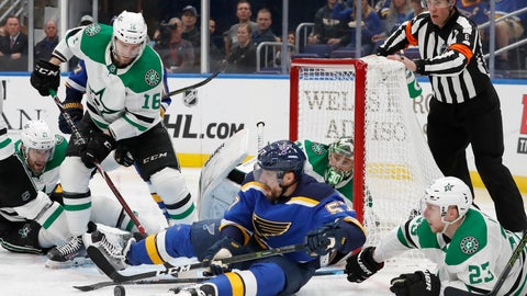 <p>               St. Louis Blues left wing David Perron (57) reaches for the puck after falling to the ice with Dallas Stars defenseman Esa Lindell (23), of Finland, during the second period in Game 5 of an NHL second-round hockey playoff series Friday, May 3, 2019, in St. Louis. (AP Photo/Jeff Roberson)             </p>