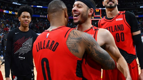 <p>               From front, Portland Trail Blazers guard Damian Lillard celebrates with guard Seth Curry and center Enes Kanter after the second half of Game 7 of an NBA basketball second-round playoff series Sunday, May 12, 2019, in Denver. The Trail Blazers won 100-96. (AP Photo/David Zalubowski)             </p>