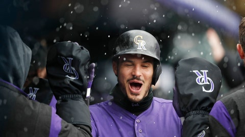<p>               Colorado Rockies' Nolan Arenado is congratulated as he returns to the dugout after hitting a two-run home run off San Francisco Giants starting pitcher Derek Holland in the first inning of a baseball game Thursday, May 9, 2019, in Denver. (AP Photo/David Zalubowski)             </p>