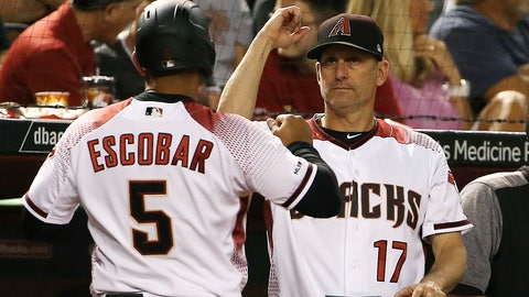 <p>               Arizona Diamondbacks manager Torey Lovullo (17) celebrates a run scored against the Pittsburgh Pirates by Eduardo Escobar (5) during the second inning of a baseball game Monday, May 13, 2019, in Phoenix. (AP Photo/Ross D. Franklin)             </p>
