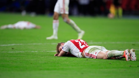 <p>               Ajax's Frenkie de Jong lies on the pitch at the end of the Champions League semifinal second leg soccer match between Ajax and Tottenham Hotspur at the Johan Cruyff ArenA in Amsterdam, Netherlands, Wednesday, May 8, 2019. (AP Photo/Peter Dejong)             </p>