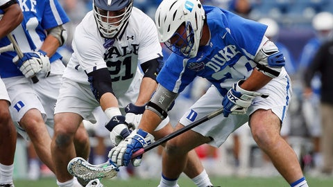 <p>               FILE - In this May 28, 2018, file photo, Yale's Conor Mackie (21) battles Duke's Brian Smyth, right, for the ball during the first half in the championship game of the NCAA college Division I lacrosse tournament in Foxborough, Mass. The men's lacrosse tournament which gets underway in earnest this weekend when Yale hosts Big East champion Georgetown in a first-round game on Saturday (AP Photo/Michael Dwyer, File)             </p>