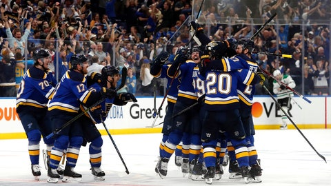 """<p>               FILE - In this May 7, 2019, file photo, St. Louis Blues celebrate after defeating the Dallas Stars in double overtime in Game 7 of an NHL second-round hockey playoff series in St. Louis. The Blues won 29 of their final 43 games to go from last place in the NHL to the Western Conference final. They adopted Laura Branigan's song """"Gloria"""" in January after hearing it at a private South Philadelphia bar. (AP Photo/Jeff Roberson, File)             </p>"""