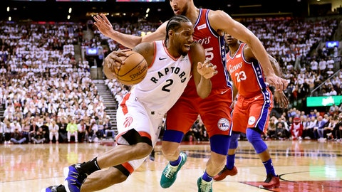 <p>               Philadelphia 76ers guard Ben Simmons (25) defends as Toronto Raptors forward Kawhi Leonard (2) drives to the basket during second half NBA Eastern Conference basketball semifinal action in Toronto on Sunday, May 12, 2019. (Frank Gunn/The Canadian Press via AP)             </p>