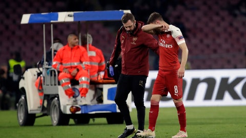 <p>               Arsenal's Aaron Ramsey leaves the pitch after his injuring during the Europa League second leg quarterfinal soccer match between Napoli and Arsenal at San Paolo stadium in Naples, Italy, Thursday, April 18, 2019. (AP Photo/Luca Bruno)             </p>