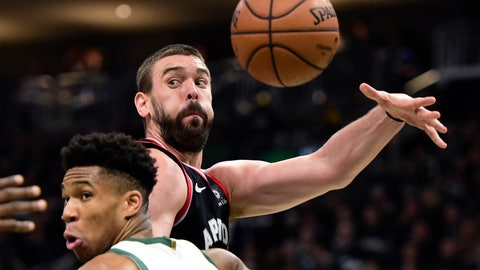 <p>               Toronto Raptors center Marc Gasol (33) throws a pass as Milwaukee Bucks forward Giannis Antetokounmpo (34) defends during the second half of Game 2 of the NBA basketball playoffs Eastern Conference finals, Friday, May 17, 2019, in Milwaukee. (Frank Gunn/The Canadian Press via AP)             </p>