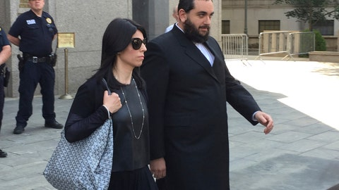 <p>               FILE - In this Monday, June 20, 2016, file photo, Brooklyn businessman Jeremy Reichberg, right, leaves Manhattan federal court in New York, after he was charged with showering New York Police Department officials with tens of thousands of dollars in bribes, including vacations, prostitutes and home improvements so that he could use the NYPD as his private police force. On Monday, May 13, 2019, Reichberg was fined and sentenced to four years in prison. (AP Photo/Larry Neumeister, File)             </p>