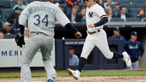 <p>               New York Yankees' Mike Tauchman scores on DJ LeMahieu's second-inning single as Seattle Mariners starting pitcher Felix Hernandez (34) heads toward the plate during a baseball game, Monday, May 6, 2019, in New York. (AP Photo/Kathy Willens)             </p>