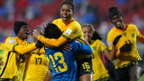<p>               FILE - In this Oct. 17, 2018, file photo, Jamaica's Dominique Bond-flasza (16) and Nicole McClure (13) celebrate after Bond-flasza scored the game-winning penalty kick to defeat Panama in the third place match of the CONCACAF women's World Cup qualifying tournament in Frisco, Texas. Just a handful of years ago, Jamaica didn't even have a women's national team. The Reggae Girlz, as they're known, are also the first Caribbean team to qualify for the Women's World Cup, which opens June 7 in France. (AP Photo/Richard W. Rodriguez, File)             </p>