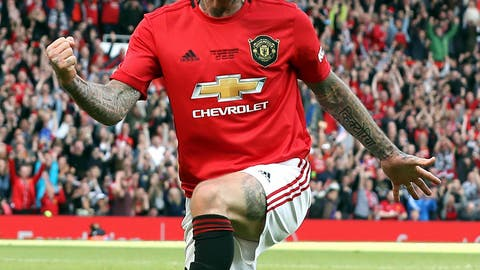 <p>               Manchester United Legend's David Beckham celebrates scoring his side's fifth goal of the game during the legends match between Manchester United Legends and Bayern Munich Legens at Old Trafford, Manchester, England, Sunday, May 26, 2019. (Martin Rickett/PA via AP)             </p>