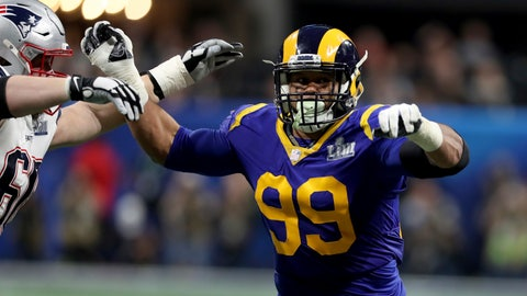 <p>               FILE - In this Feb. 3, 2019, file photo, Los Angeles Rams Aaron Donald (99) rushes against the New England Patriots during NFL Super Bowl 53 in Atlanta. Two-time reigning defensive player of the year Aaron Donald is always searching for out-of-the-box ways to improve his game. That's why the Rams defensive lineman trained with knives again this offseason. That's right, knives, of the plastic variety, of course, in order to improve his eye-hand coordination. His real driving force? That loss to the New England Patriots in the Super Bowl last February. (AP Photo/Gregory Payan, File)             </p>