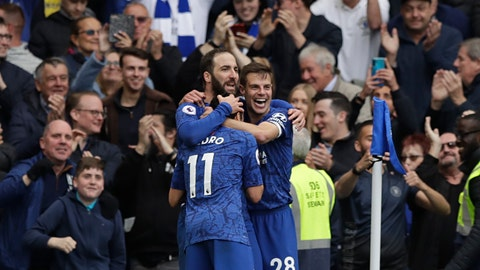 <p>               Chelsea's Gonzalo Higuain, left, celebrates with teammate Cesar Azpilicueta, right, and Pedro after scoring his side's third goal during the English Premier League soccer match between Chelsea and Watford at Stamford Bridge stadium in London, Sunday, May 5, 2019. (AP Photo/Matt Dunham)             </p>