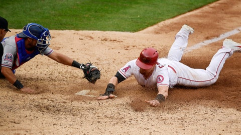 <p>               Los Angeles Angels' Kole Calhoun, right, scores on a wild pitch ahead of the tag of Texas Rangers catcher Isiah Kiner-Falefa during the seventh inning of a baseball game Sunday, May 26, 2019, in Anaheim, Calif. (AP Photo/Mark J. Terrill)             </p>