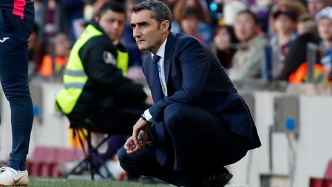 <p>               Barcelona coach Ernesto Valverde looks at the game during the Spanish La Liga soccer match between FC Barcelona and Getafe at the Camp Nou stadium in Barcelona, Spain, Sunday, May 12, 2019. (AP Photo)             </p>