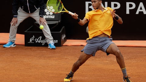 <p>               FILE - In this Monday, May, 13, 2019 filer, Canada's Felix Auger-Aliassime returns the ball to Croatia's Borna Coric during their match at the Italian Open tennis tournament, in Rome. It's typically Canadian that Denis Shapovalov, Felix Auger-Aliassime and Bianca Andreescu are each children of immigrants. What's not typical is that they have all simultaneously broken into the world's elite ranks of tennis players _ and will all be worth watching when the French Open begins Sunday. (AP Photo/Gregorio Borgia, File)             </p>