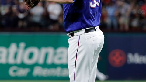 <p>               Texas Rangers starting pitcher Lance Lynn jumps off the mound after giving up an RBI single to Seattle Mariners' Omar Narvaez during the seventh inning of a baseball game in Arlington, Texas, Tuesday, May 21, 2019. (AP Photo/Tony Gutierrez)             </p>
