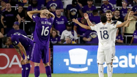 <p>               LA Galaxy's Uriel Antuna (18) celebrates with Efrain Alvarez as Orlando City's Kyle Smith, left, and Sacha Kljestan (16) react at the end of an MLS soccer match Friday, May 24, 2019, in Orlando, Fla. The Galaxy won 1-0. (AP Photo/John Raoux)             </p>