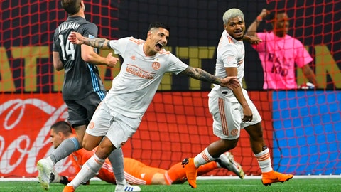 <p>               Atlanta United's defender Franco Escobar reacts after scoring a goal against Minnesota United as Josef Martinez, right celebrates with him during the first half of an MLS soccer match Wednesday, May 29, 2019, in Atlanta. (AP Photo/John Amis)             </p>