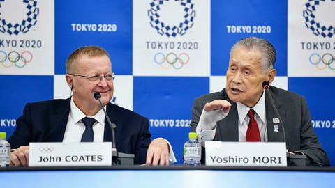 """<p>               John Coates, left, chairman of the IOC Coordination Commission for the 2020 Tokyo Olympics and Paralympics, Tokyo Olympic organizing committee President Yoshiro Mori, right, attend a press conference Thursday, May 23, 2019, in Tokyo. A top Olympic official has made a guarantee that should please world sports federations that are concerned that organizers of next year's Tokyo games might be cutting things that federations view as """"essential."""" (Tsuyoshi Ueda/Kyodo News via AP)             </p>"""
