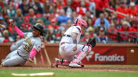<p>               Pittsburgh Pirates' Josh Bell, left, scores a run as St. Louis Cardinals catcher Yadier Molina, right, waits for the ball during the eighth inning of a baseball game Sunday, May 12, 2019, in St. Louis. (AP Photo/Scott Kane)             </p>