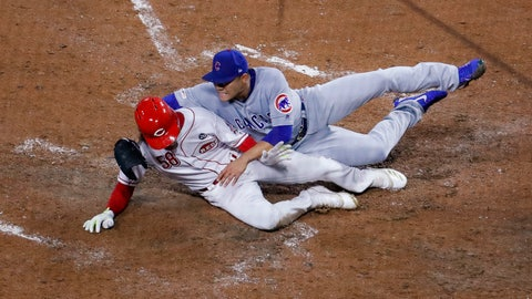 <p>               Cincinnati Reds' Luis Castillo (58) scores on a wild pitch by Chicago Cubs starting pitcher Jose Quintana, right, during the fifth inning of a baseball game Thursday, May 16, 2019, in Cincinnati. (AP Photo/John Minchillo)             </p>