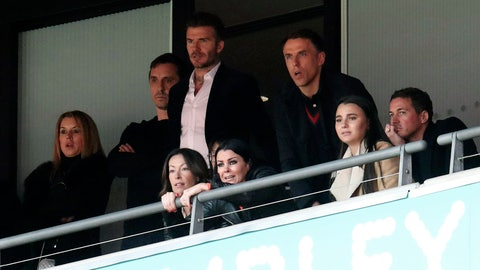 <p>               Salford City co-owners Gary Neville, second left, David Beckham, center, and Phil Neville watch the National League Play-off Soccer Final at Wembley Stadium, London, Saturday, May 11, 2019. David Beckham watched on at Wembley as Salford secured their Football League place with a 3-0 win over AFC Fylde in the Vanarama National League play-off final. The former England captain joined some of his fellow co-owners from Manchester United's 'Class of 92' to cheer on Graham Alexander's side as the club secured promotion to the Football League for the first time. (Bradley Collyer/PA via AP)             </p>