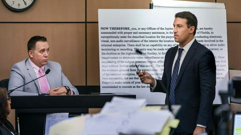 <p>               Alex Spiro, right, attorney for New England Patriots owner Robert Kraft, stands in front of a copy of a search warrant as he questions Jupiter Police Detective Andrew Sharp during a motion hearing in the Kraft prostitution solicitation case, Wednesday, May 1, 2019, in West Palm Beach, Fla. Kraft's attorneys argue that undercover surveillance videos allegedly showing their client paying for sex at a Jupiter day spa should be ruled inadmissible and the evidence thrown out. (Lannis Waters/Palm Beach Post via AP, Pool)             </p>