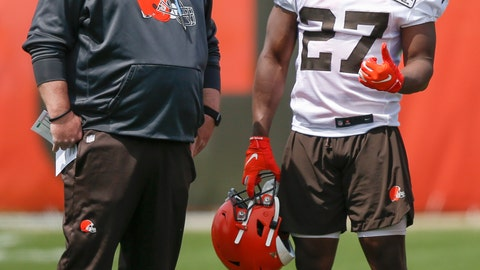 """<p>               FILE - In this May 15, 2019, file photo, Cleveland Browns' Kareem Hunt (27) talks with head coach Freddie Kitchens during an NFL football organized team activity session at the team's training facility in Berea, Ohio. Kitchens has been watching Kareem Hunt work toward redemption. On Sunday, May 19, Kitchens showed the running back that he's got his full support. Kitchens and general manager John Dorsey surprised Hunt by attending his baptism at True Vine Missionary Baptist Church on Cleveland's east side. Hunt, who has been suspended eight games by the NFL for two physical altercations, including one in which he shoved and kicked a woman, said last week he wanted """"to feel reborn.""""(AP Photo/Ron Schwane, File)             </p>"""