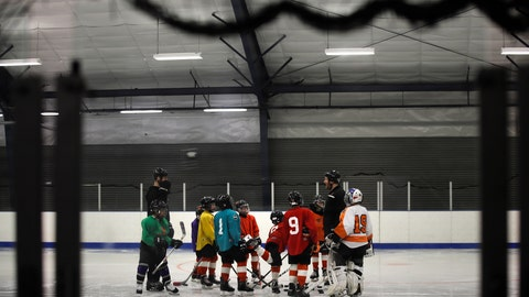 <p>               FILE - In this Feb. 21, 2019, file photo, Malakye Johnson (1) gathers with his teammates during a Snider Hockey practice at the Scanlon Ice Rink in Philadelphia. The Philadelphia-based Snider Hockey organization named after the late Flyers owner now has over 3,000 kids in its program and almost a third are girls. Snider Hockey officials want to get to a point that boys and girls are split 50-50, and a new endeavor with the Howe Foundation is another step toward that goal. (AP Photo/Matt Rourke, File)             </p>