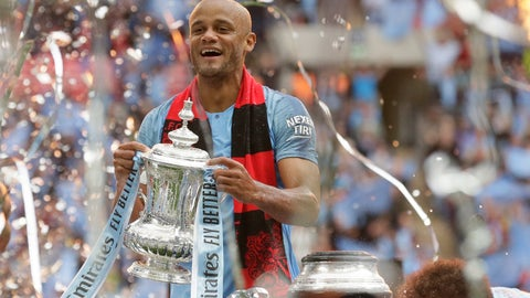 <p>               Manchester City's team captain Vincent Kompany lifts the trophy after winning the English FA Cup Final soccer match between Manchester City and Watford at Wembley stadium in London, Saturday, May 18, 2019. Manchester City won 6-0. (AP Photo/Tim Ireland)             </p>