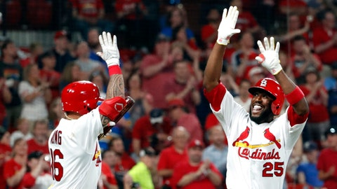 St. Louis Cardinals' Dexter Fowler, right, is congratulated by Kolten Wong after hitting a solo home run during the sixth inning in the second game of the team's baseball doubleheader against the Kansas City Royals on Wednesday, May 22, 2019, in St. Louis. (AP Photo/Jeff Roberson)