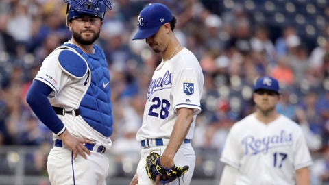Kansas City Royals starting pitcher Jorge Lopez (28) stands on the mound with catcher Cam Gallagher, left, before coming out during the second inning of the second baseball game of a doubleheader against the New York Yankees, Saturday, May 25, 2019, in Kansas City, Mo. (AP Photo/Charlie Riedel)