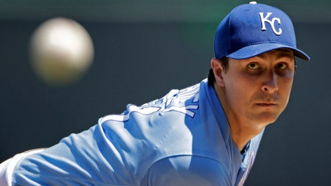 Kansas City Royals starting pitcher Homer Bailey throws during the first inning of a baseball game against the Texas Rangers, Thursday, May 16, 2019, in Kansas City, Mo. (AP Photo/Charlie Riedel)