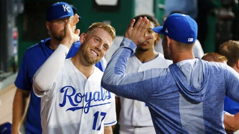 May 25, 2019; Kansas City, MO, USA; Kansas City Royals first baseman Hunter Dozier (17) is congratulated after scoring against the New York Yankees during the fourth inning in the second game of a double header at Kauffman Stadium. Mandatory Credit: Jay Biggerstaff-USA TODAY Sports