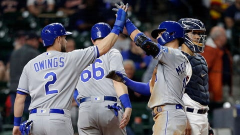 Kansas City Royals' Chris Owings (2) high-fives Whit Merrifield (15) at the plate after Merrifield's grand slam during the seventh inning of the team's baseball game against the Houston Astros on Tuesday, May 7, 2019, in Houston. (AP Photo/Michael Wyke)