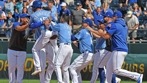 May 26, 2019; Kansas City, MO, USA; Kansas City Royals right fielder Whit Merrifield (15) celebrates with his teammates after driving in the game winning run during the tenth inning against the New York Yankees at Kauffman Stadium. Mandatory Credit: Peter G. Aiken/USA TODAY Sports