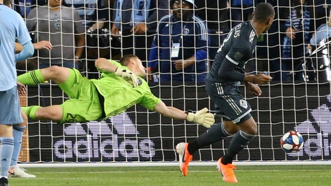 May 18, 2019; Kansas City, KS, USA; Vancouver Whitecaps defenseman Derek Cornelius (13) scores a goal past Sporting Kansas City goalkeeper Tim Melia (29) to tie the game in stoppage time during the second half at Children's Mercy Park. Mandatory Credit: Jay Biggerstaff-USA TODAY Sports