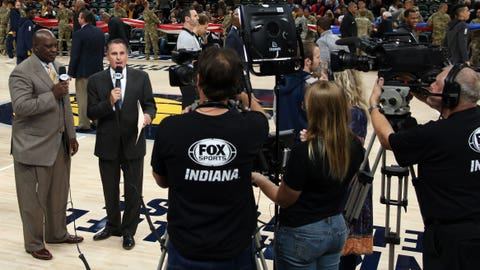 Pacers announcers Quinn Buckner (left), Chris Denari and part of the FOX Sports Indiana production team.