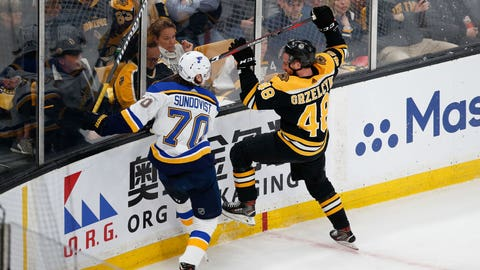 May 29, 2019; Boston, MA, USA;  St. Louis Blues center Oskar Sundqvist (70) boards Boston Bruins defenseman Matt Grzelcyk (48) during the first period in game two of the 2019 Stanley Cup Final at TD Garden. Mandatory Credit: Greg M. Cooper-USA TODAY Sports