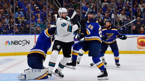 May 15, 2019; St. Louis, MO, USA; St. Louis Blues defenseman Vince Dunn (29) is hit in the face by the puck as he defends against San Jose Sharks center Melker Karlsson (68) during the first period in game three of the Western Conference Final of the 2019 Stanley Cup Playoffs at Enterprise Center. Mandatory Credit: Jeff Curry-USA TODAY Sports