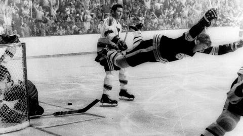 FILE - In this May 10, 1970, file photo, Boston Bruins' Bobby Orr goes into the air after scoring a goal against the St. Louis Blues that won the Stanley Cup for the Bruins, in Boston. Orr and the big, bad Boston Bruins swept the expansion-era Blues in that series. Now 49 years later, Boston is in its third final in nine seasons and St. Louis is back for the first time since 1970 (Ray Lussier/The Boston Herald via AP, File)