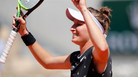 <p>               Marketa Vondrousova of the Czech Republic celebrates winning her fourth round match of the French Open tennis tournament against Latvia's Anastasija Sevastova in two sets 6-2, 6-0, at the Roland Garros stadium in Paris, Sunday, June 2, 2019. (AP Photo/Christophe Ena)             </p>