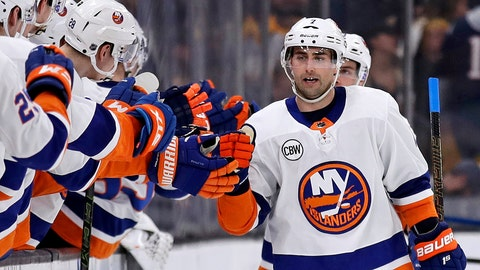 <p>               FILE - In this Feb. 5, 2019, file photo, New York Islanders right wing Jordan Eberle, right, is congratulated after his second period goal against the Boston Bruins during an NHL hockey game in Boston. The New York Islanders have re-signed winger Jordan Eberle to a $27.5 million, five-year contract. Eberle counts $5.5 million against the salary through the 2023-24 season on the deal general manager Lou Lamoriello announced Friday, June 14, 2019. (AP Photo/Charles Krupa, File)             </p>