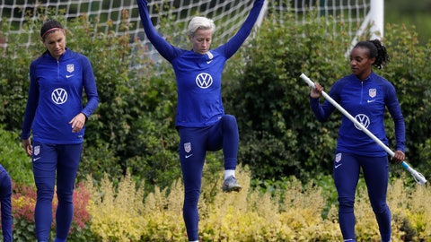<p>               US player Megan Rapinoe, center, stretches with Crystal Dunn, right, and Alex Morgan, left, during a US womens soccer team training session at the Tottenham Hotspur training centre in London, Thursday, June 6, 2019. The Women's World Cup starts in France on June 7. (AP Photo/Kirsty Wigglesworth)             </p>