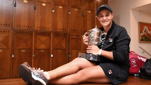 <p>               In this image released Saturday, June 8, 2019 by the French Tennis Federation Australia's Ashleigh Barty holds the trophy in the locker room after winning her women's final match of the French Open tennis tournament against Marketa Vondrousova of the Czech Republic in two sets 6-1, 6-3, at the Roland Garros stadium in Paris. (Corinne Dubreuil, FFT, via AP Photo)             </p>
