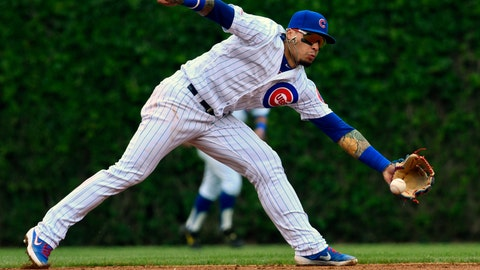 <p>               Chicago Cubs shortstop Javier Baez (9) catches a ball hit by Cincinnati Reds' Jose Peraza (9) during the second inning of a baseball game Sunday, May 26, 2019, in Chicago. (AP Photo/Matt Marton)             </p>