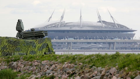 <p>               FILE - In this June 12, 2018, file photo, a Pantsir antiaircraft missile system, left, stands on guard of the air space above Saint Petersburg stadium which will host some 2018 World Cup matches in St.Petersburg, Russia. A year after hosting the World Cup, Russia is boasting the biggest club soccer crowds since Soviet days and participation at the amateur level is on the rise. Still, there are signs of trouble for the sport. (AP Photo/Dmitri Lovetsky, File)             </p>