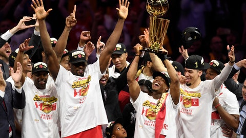 <p>               Toronto Raptors guard Kyle Lowry, center right, holds Larry O'Brien NBA Championship Trophy after the Raptors defeated the Golden State Warriors 114-110 in Game 6 of basketball's NBA Finals, Thursday, June 13, 2019, in Oakland, Calif. (Frank Gunn/The Canadian Press via AP)             </p>